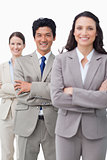 Smiling businessteam standing with folded arms