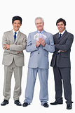 Smiling senior salesman with money and employees
