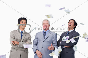 Money raining down on businessteam