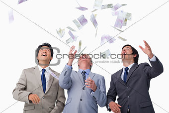 Bank notes raining down on businessteam