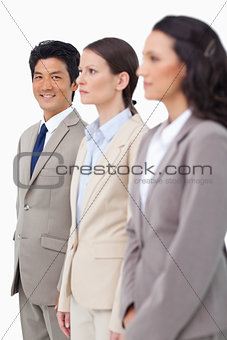 Smiling businessman next to colleagues