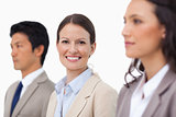 Smiling saleswoman between her colleagues