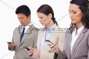 Businessteam looking at their cellphones