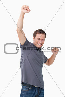 Victorious young man raising fist