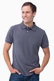 Smiling male with hands in his pockets