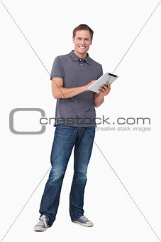 Smiling young man with his tablet computer