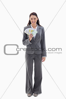 Businesswoman smiling with a lot of bank notes in her hand