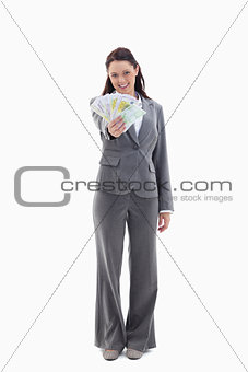 Happy businesswoman with a lot of bank notes in her hand