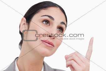 Close up of businesswoman looking and pointing up