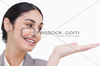 Close up of smiling businesswoman looking at her palm