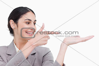 Close up of businesswoman pointing at her palm