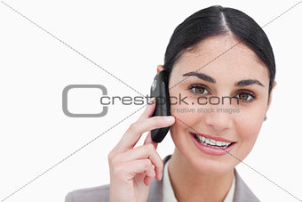 Close up of smiling businesswoman talking on cellphone