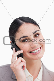 Close up of smiling businesswoman on her cellphone