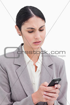 Close up of businesswoman confused by text message