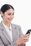 Close up of smiling businesswoman reading text message