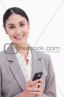 Close up of smiling businesswoman holding cellphone