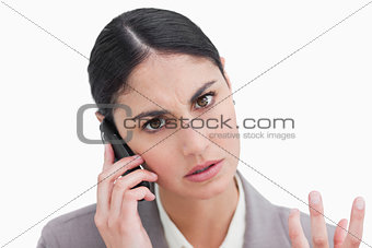 Close up of angry businesswoman on her cellphone