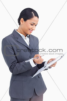 Close up of saleswoman with clipboard and pen