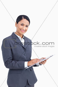 Close up of saleswoman with pen and clipboard