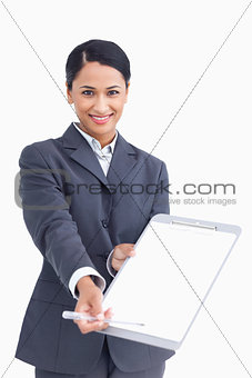 Close up of smiling saleswoman asking for signature