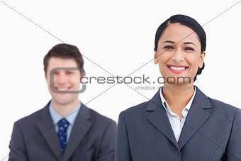Close up of smiling saleswoman with colleague behind her