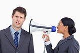 Close up of saleswoman with megaphone yelling at colleague