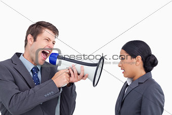 Close up of salesman with megaphone yelling at colleague