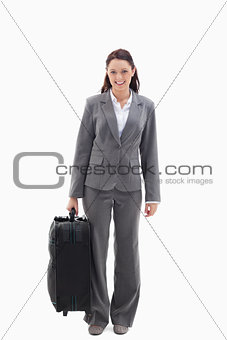 Businesswoman smiling with a suitcase
