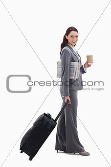 Profile of a businesswoman smiling going for a trip