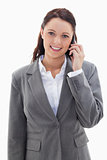 Businesswoman smiling over the phone