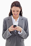 Businesswoman smiling and watching her phone