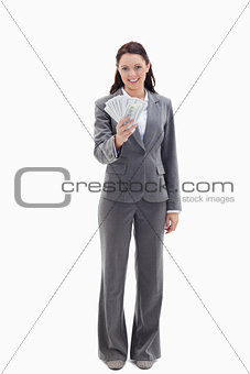 Businesswoman smiling and holding a lot of dollar bank notes