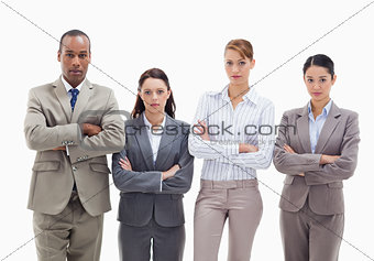 Business team side by side crossing their arms