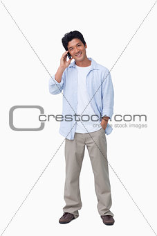Smiling male on cellphone