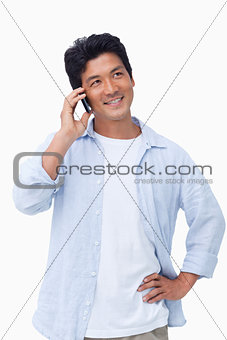 Smiling male on his mobile phone