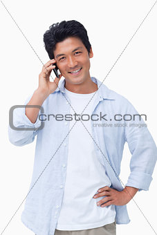 Smiling male on mobile phone