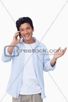 Smiling male talking on the cellphone