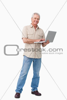 Smiling mature male with his laptop