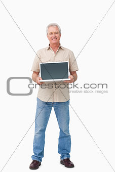 Smiling mature male presenting his laptop screen