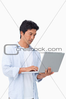 Young male working on his laptop