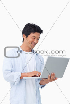 Smiling male on his laptop