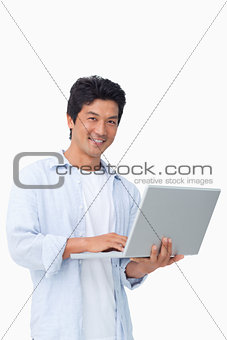 Smiling male with his laptop