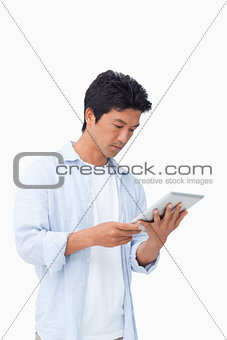 Male looking at his tablet computer