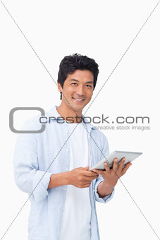 Smiling male with his tablet computer