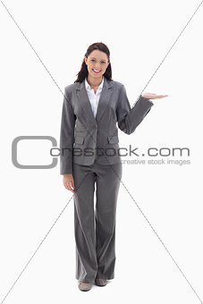 Businesswoman smiling and presenting a product