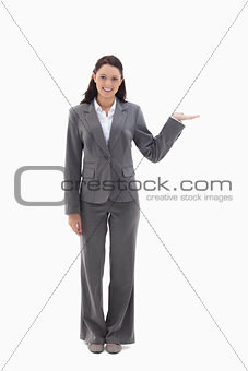 Smiling businesswoman and presenting a product