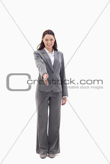 Businesswoman smiling and holding out her hand