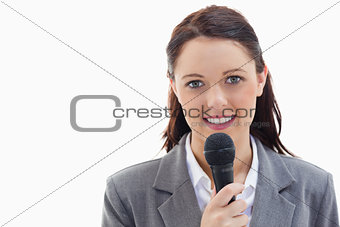 Businesswoman holding a microphone