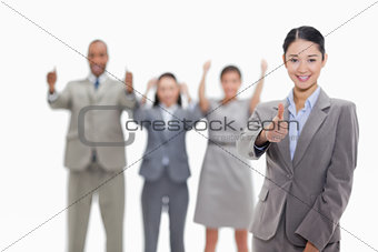 Approving business team with thumbs-up