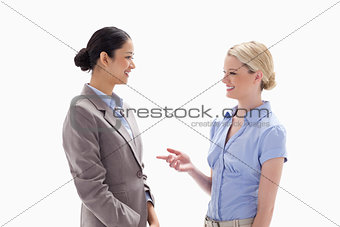 Two women talking happily